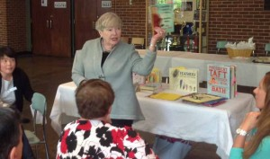 Pat Keogh sharing books with volunteers